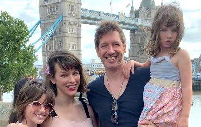 Pregnant Milla Jovovich Cradles Growing Baby Bump in New Family Pic