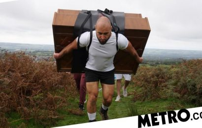 Former Royal Marine climbs mountain with 400lb piano on his back for charity