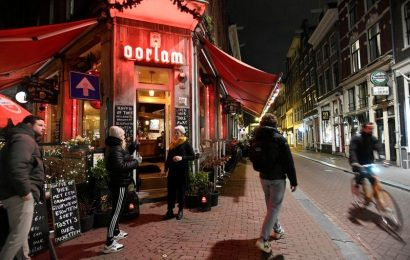 Dutch say face masks can go as COVID-19 cases drop